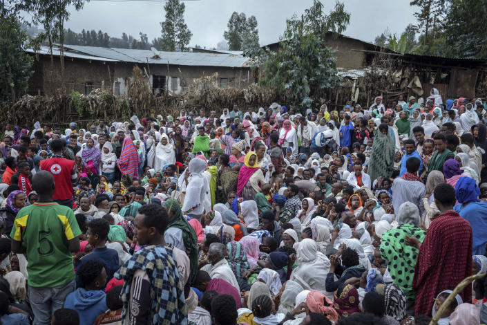 Displaced Ethiopians from different towns in the Amhara region wait for aid distributions at a center for the internally-displaced in Debark, in the Amhara region of northern Ethiopia Friday, Aug. 27, 2021. As they bring war to other parts of Ethiopia such as the Amhara region, resurgent Tigray fighters face growing allegations that they are retaliating for the abuses their people suffered back home, sending hundreds of thousands of people fleeing in the past two months. (AP Photo/Mulugeta Ayene)