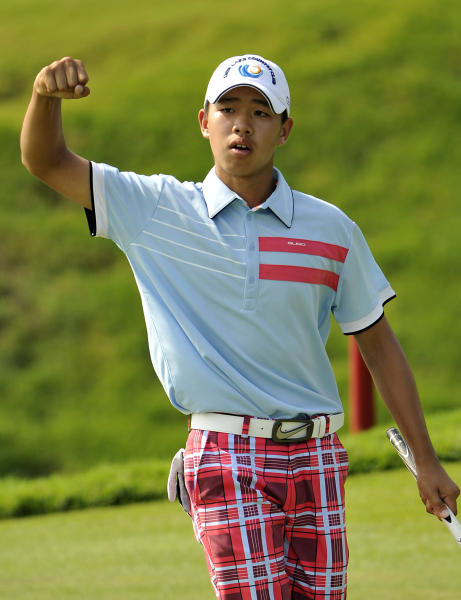 Guan Tianlang of China gesture during the final round of the Asia-Pacific Amateur Championship at Amata Spring Country Club, in Chonburi, Thailand Sunday, Nov. 4, 2012. (AP Photo/AAC, Paul Lakatos) NO LICENSING
