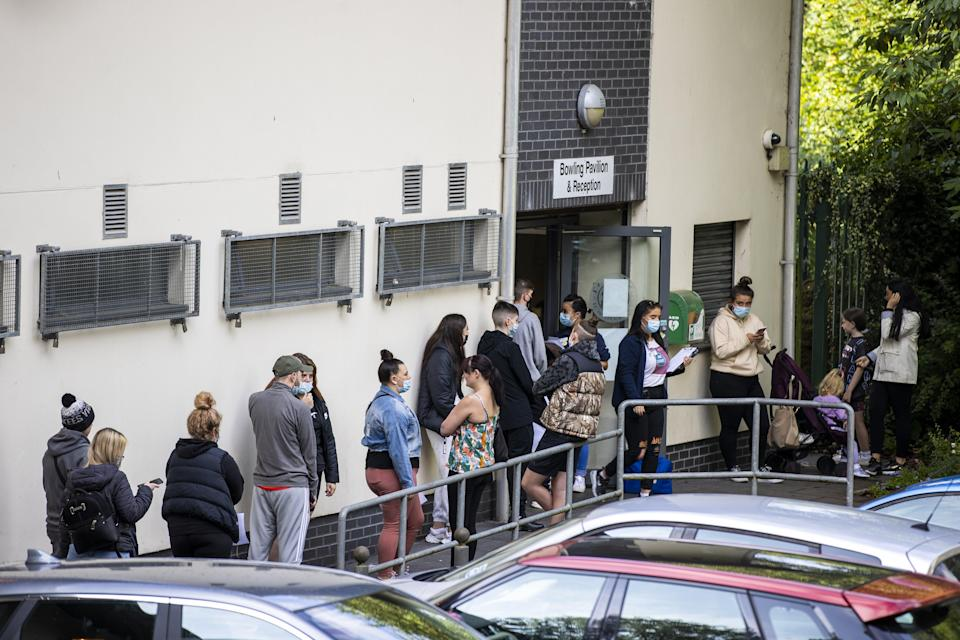 Festival goers at Feile an Phobail queuing to receive their first vaccination (Liam McBurney/PA) (PA Wire)