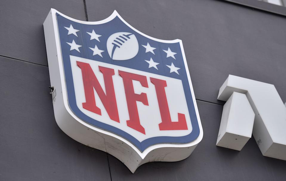 "The NFL logo is seen on the side of the NFL Network building in Culver City, a westside neighborhood of Los Angeles on August 24, 2020. - A rash of COVID-19 results that forced multiple NFL teams to adjust their weekend training plans were false positives due to ""isolated contamination during test preparation,"" the lab responsible said August 24, 2020. (Photo by Chris DELMAS / AFP) (Photo by CHRIS DELMAS/AFP via Getty Images)"