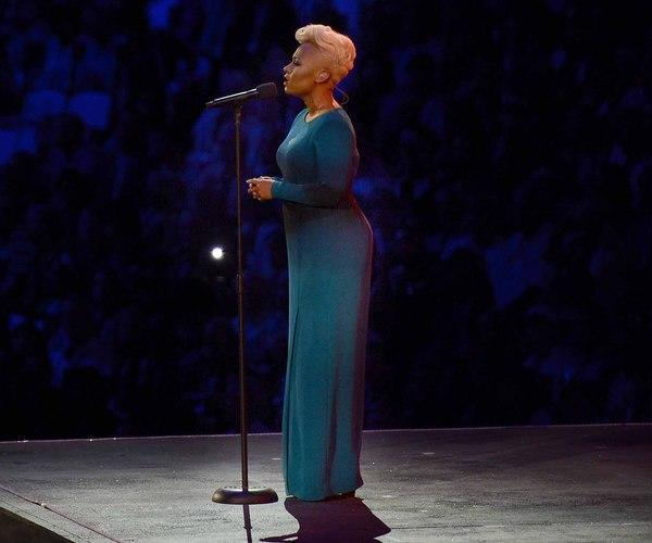 """You could practically hear the collective """"ahhh"""" when Scottish singer Emeli Sande stepped out onto the stage during the Opening Ceremony in this Jonathan Saunders blue-black ombré gown. Emeli Sande; Photo by Keystone Press"""