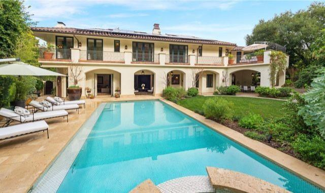 Tucked away in Mulholland Estates, the Mediterranean villa spans 7,700 square feet and expands to a spacious deck and a series of balconies.
