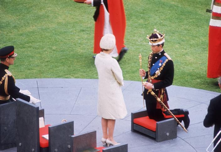 1st July 1969:  Queen Elizabeth II crowns her son Charles, Prince of Wales, during his investiture ceremony at Caernarvon Castle.  (Photo by Fox Photos/Getty Images)