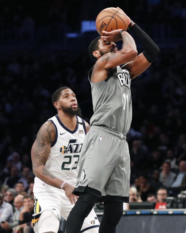 Brooklyn Nets guard Kyrie Irving (11) shoots in front of Utah Jazz forward Royce O'Neale during the second quarter of an NBA basketball game Tuesday, Jan. 14, 2020, in New York. (AP Photo/Kathy Willens)