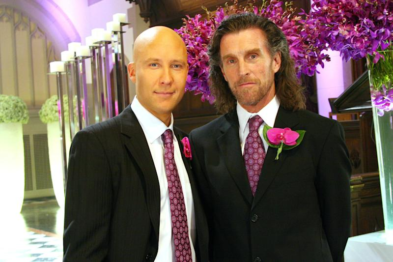 Lex and Lionel Luthor (Michael Rosenbaum and John Glover) strike a family pose in 'Smallville' (Photo: Michael Courtney / © Warner Brothers Television / Courtesy Everett Collection)