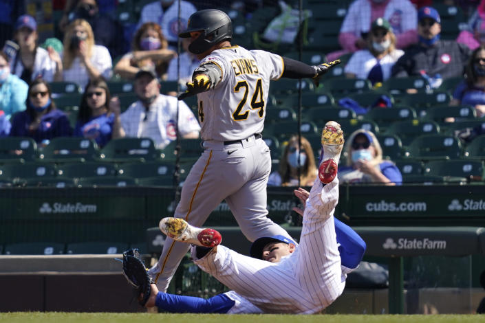 Pittsburgh Pirates' Phillip Evans (24) is put out at first by Chicago Cubs first baseman Anthony Rizzo during the fourth inning of a baseball game in Chicago, Sunday, April 4, 2021. (AP Photo/Nam Y. Huh)