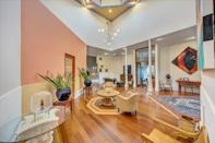 <p>And we love how the wooden floors contrast with the peach and yellow paint, too.</p>