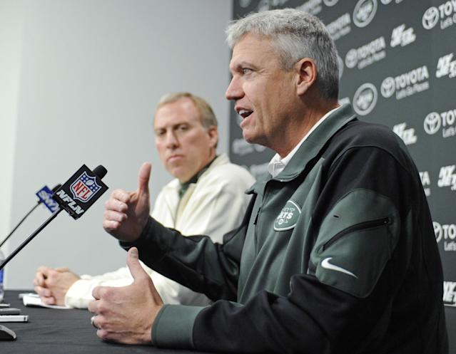 New York Jets coach Rex Ryan, right, and general manager John Idzik speak to the media during an NFL football news conference Tuesday, Dec. 31, 2013, in Florham Park, N.J. (AP Photo/Bill Kostroun)