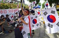 Supporters of South Korea's ousted president Park Geun-Hye wave national flags during a rally demanding the release of Samsung heir Lee Jae-Yong