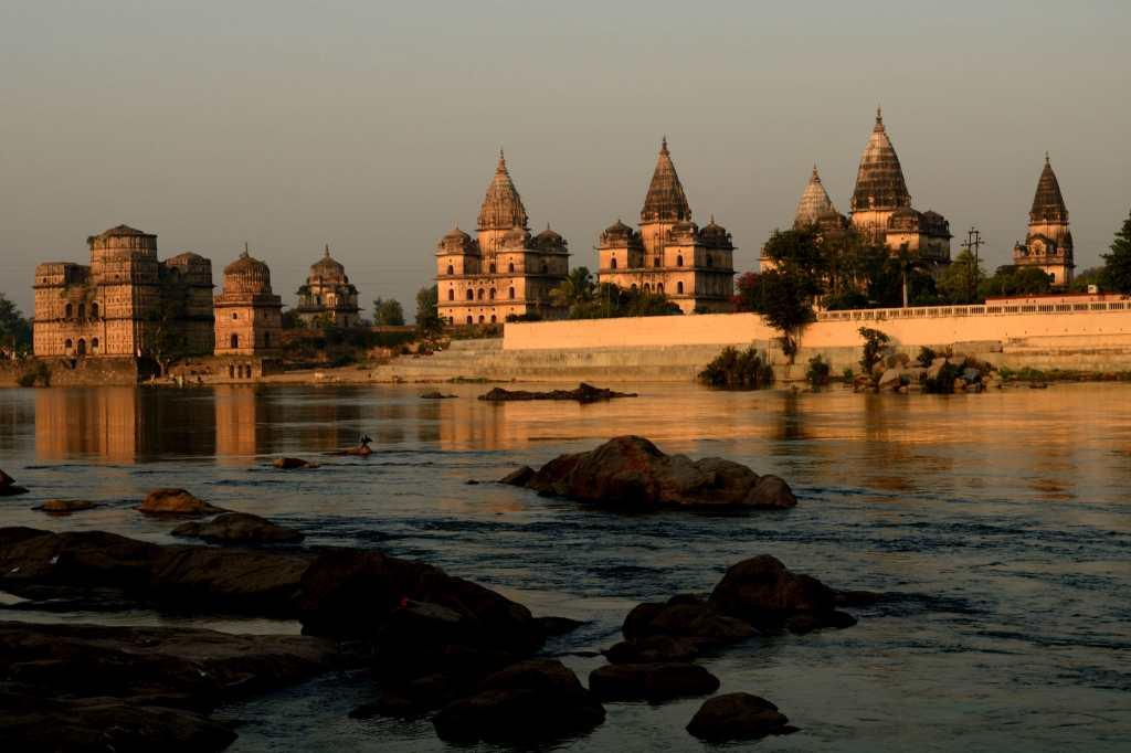"<b>4.	 Orchha , Madhya Pradesh </b><br><br>Set against the Betwa River are the Chhatris or the cenotaphs of the Bundelkhand kings, glowing in the rays of the morning sun. There is beauty in ruins, in temples, and in palaces and even in tombs. Beyond the terrace of the Raj Mahal is the towering Chaturbhuj temple with the Ram Raj Mandir adjacent to it. And on the distant horizon lies the Laxmi Narayan temple, hardly visible in the mist. Delve a bit into Orchha, where the walls speak stories, where paintings reveal a culture, where tales of friendship, romance, betrayal, mysticism and sacrifice echo from every monument. Intriguing, funny, unbelievable and irresistible, these stories breathe life into the ancient mahals and mandirs.<br><a target=""_blank"" href=""http://in.lifestyle.yahoo.com/photos/orchha-the-medieval-heart-of-bundelkhand-1328780640-slideshow/"">More photos</a>"
