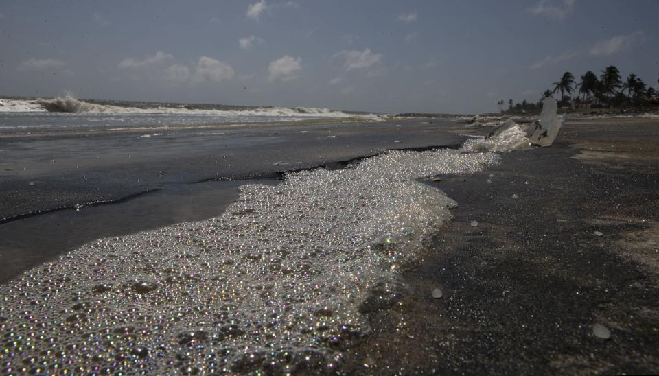 Chemical foam washed ashore from the burnt Singapore-flagged MV X-Press Pearl gathers on the beach at Kapungoda, on the outskirts of Colombo, Sri Lanka, Wednesday, June 2, 2021. Authorities in Sri Lanka were trying to head off a potential environmental disaster Thursday as the fire-damaged container ship that had been carrying chemicals was sinking off of the country's main port. The ship's operators, X-Press Feeders, say the fire destroyed most of the ship's cargo, which included 25 tons of nitric acid and other chemicals. But there are fears that remaining chemicals as well as hundreds of tons of oil from the vessel's fuel tanks could leak into the sea. (AP Photo/Eranga Jayawardena)