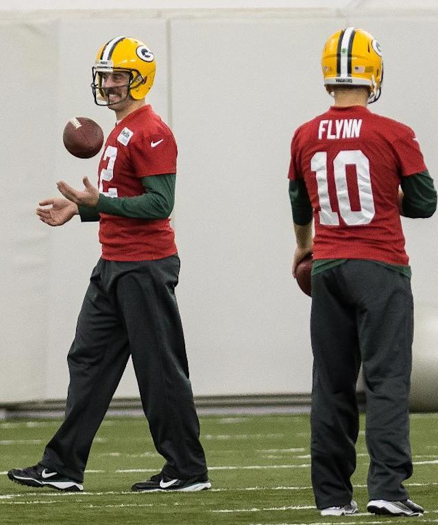 Green Bay Packers NFL football quarterback Aaron Rodgers (12) practices in Ashwaubenon, Wisc., on Tuesday, Nov. 26, 2013. At right is Packers quarterback Matt Flynn. (AP Photo/The Green Bay Press-Gazette, Lukas Keapproth)