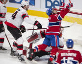 Montreal Canadiens right wing Brendan Gallagher (11) reacts to his goal, and a high stick from Ottawa Senators defenseman Erik Gudbranson (44), after scoring on Senators goaltender Joey Daccord (34) during the second period of an NHL hockey game Tuesday, March 2, 2021, in Montreal. (Ryan Remiorz/The Canadian Press via AP)