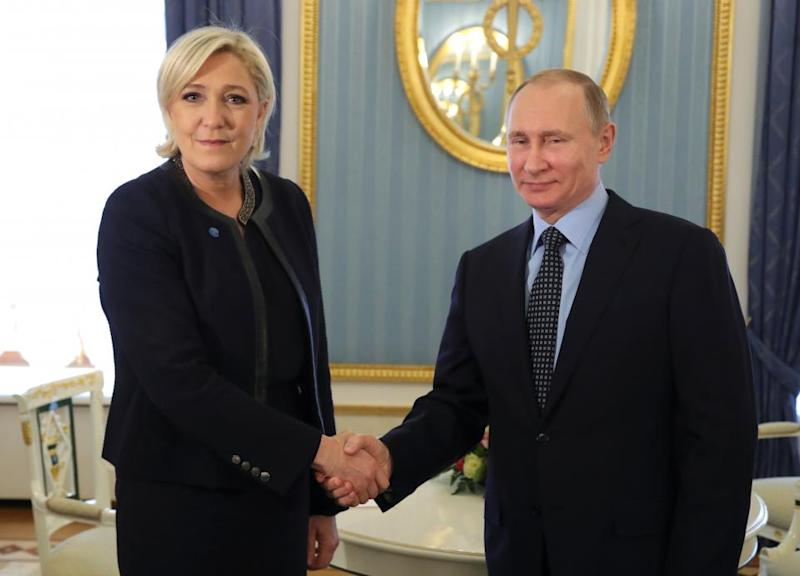 Marine Le Pen and Vladimir Putin