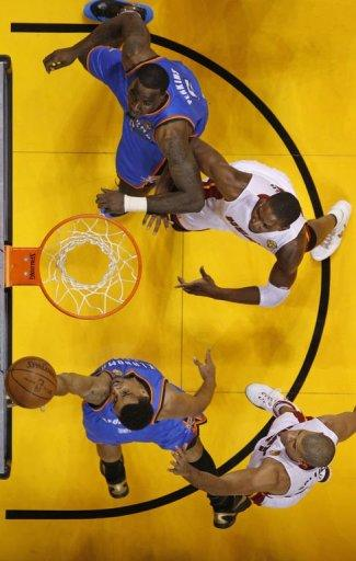 Oklahoma City Thunder Thabo Sefolosha gets off a shot against Miami Heat during the NBA Finals game between the Miami Heat and the Oklahoma City Thunder 17 June, 2012 at the American Airlines Arena in Miami, Florida