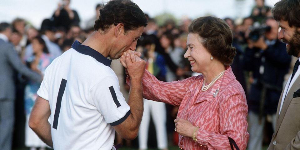 <p>Giving his mom a big kiss on the hand after she presented him with a prize at a polo match in Windsor. </p>
