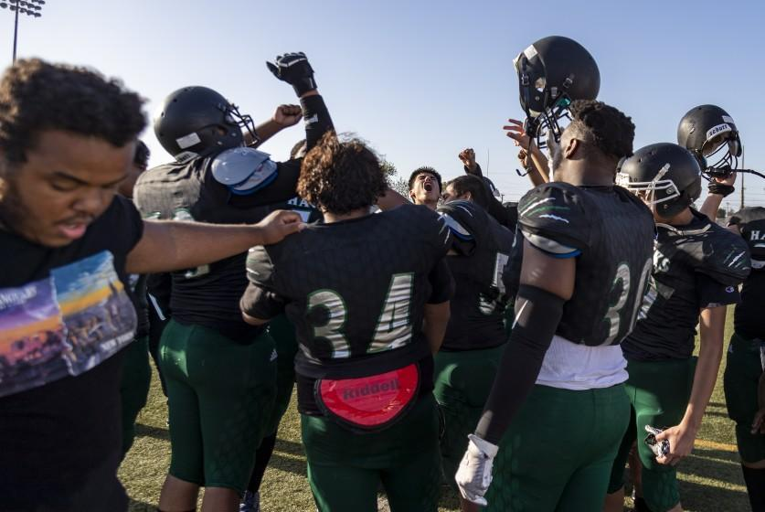 LOS ANGELES, CA - APRIL 9, 2021: Hawkins football team rallies for a cheer after losing to Manual Arts 27-0 during their first game of the season on April 9, 2021 in Los Angeles, California. Gina Ferazzi / Los Angeles Times)