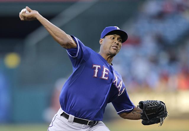 Texas Rangers starting pitcher Alexi Ogando throws against the Los Angeles Angels during the first inning of a baseball game Wednesday, Aug. 7, 2013, in Anaheim, Calif. (AP Photo/Jae C. Hong)