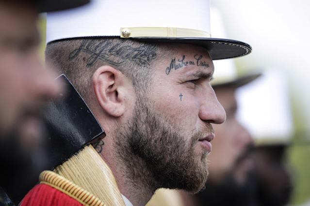 "<p>A member of the 2nd Foreign Infantry Regiment wears a tattoo with the legion's motto, ""March or Die,"" as he takes part in the annual Bastille Day military parade on the Champs-Élysées in Paris on July 14, 2018. (Photo: Thomas Samson/AFP/Getty Images) </p>"