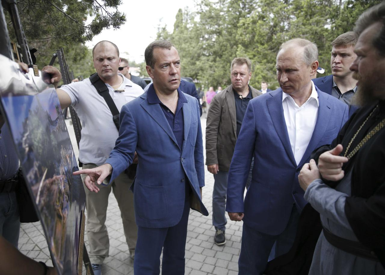 Russia's President Vladimir Putin (2nd R, front) and Prime Minister Dmitry Medvedev (C) visit Chersonesus Tavrichesky (Tauric Chersonese) National Reserve in the Black Sea port of Sevastopol, Crimea August 18, 2017. Sputnik/Dmitry Astakhov/Pool via REUTERS ATTENTION EDITORS - THIS IMAGE WAS PROVIDED BY A THIRD PARTY.