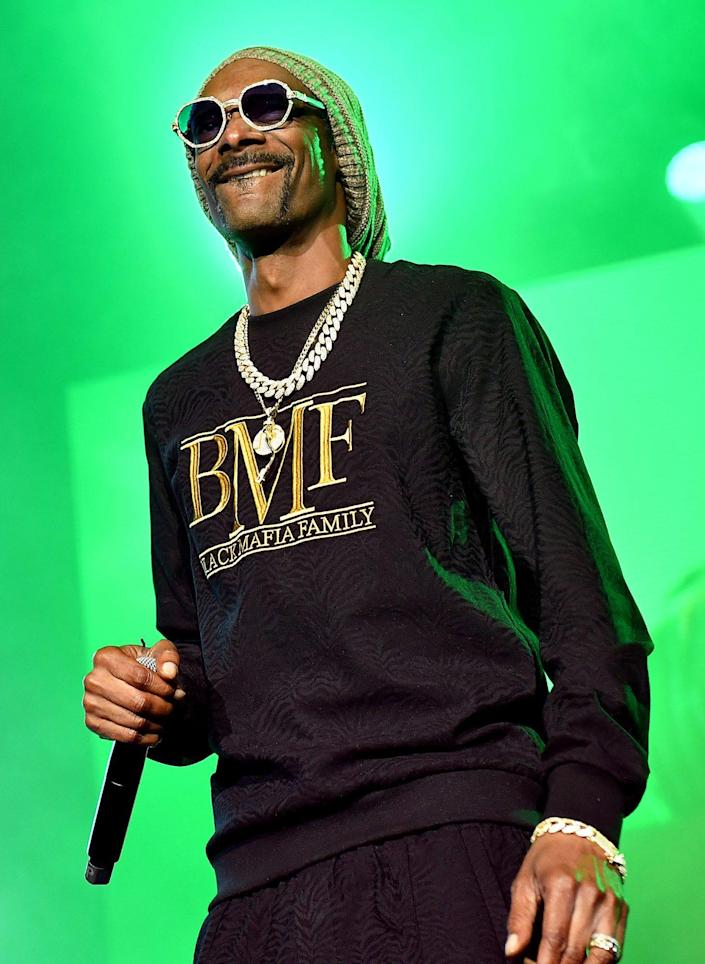 <p>Snoop Dogg performs at the world premiere screening and concert for Starz's new series <em>BMF</em> on Sept. 23 at Cellairis Amphitheatre in Atlanta. </p>