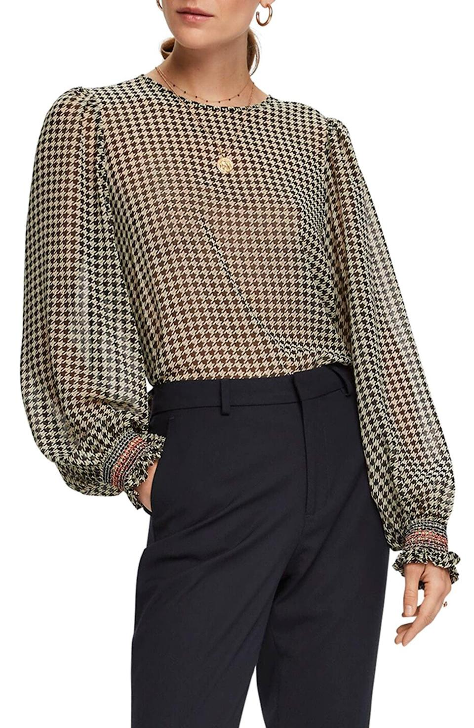<p>This <span>Scotch & Soda Houndstooth Balloon Sleeve Top</span> ($115) adds an instant touch of glam to any look.</p>