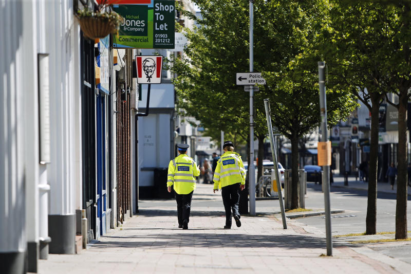 Two police officers walk through Worthing town centre as the UK continues in lockdown to help curb the spread of the coronavirus.