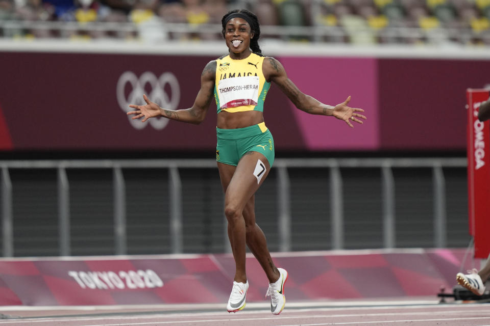 Elaine Thompson-Herah, of Jamaica, celebrates after winning the final of the women's 200-meters at the 2020 Summer Olympics, Tuesday, Aug. 3, 2021, in Tokyo. (AP Photo/David Goldman)