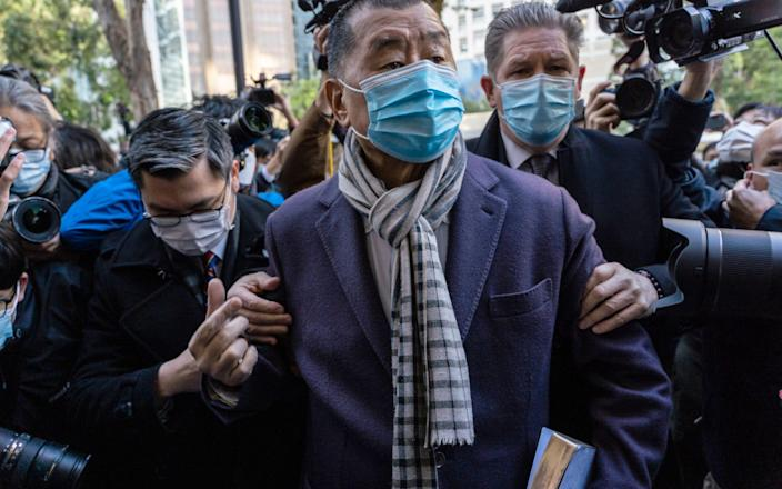Jimmy Lai arrives at court in December - Chan Long Hei/Bloomberg