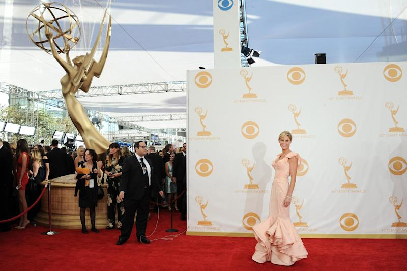 Julie Bowen, wearing Zac Posen, arrives at the 65th Primetime Emmy Awards at Nokia Theatre on Sunday Sept. 22, 2013, in Los Angeles. (Photo by Jordan Strauss/Invision/AP)