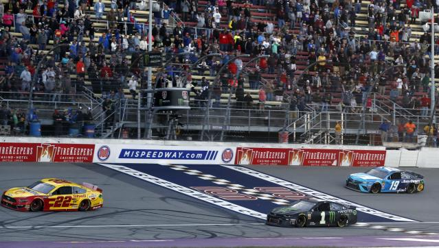 Joey Logano (22) defeats Kurt Busch (1) and Martin Truex Jr. (19) to win a NASCAR Cup Series auto race at Michigan International Speedway, Monday, June 10, 2019, in Brooklyn, Mich. (AP Photo/Carlos Osorio)
