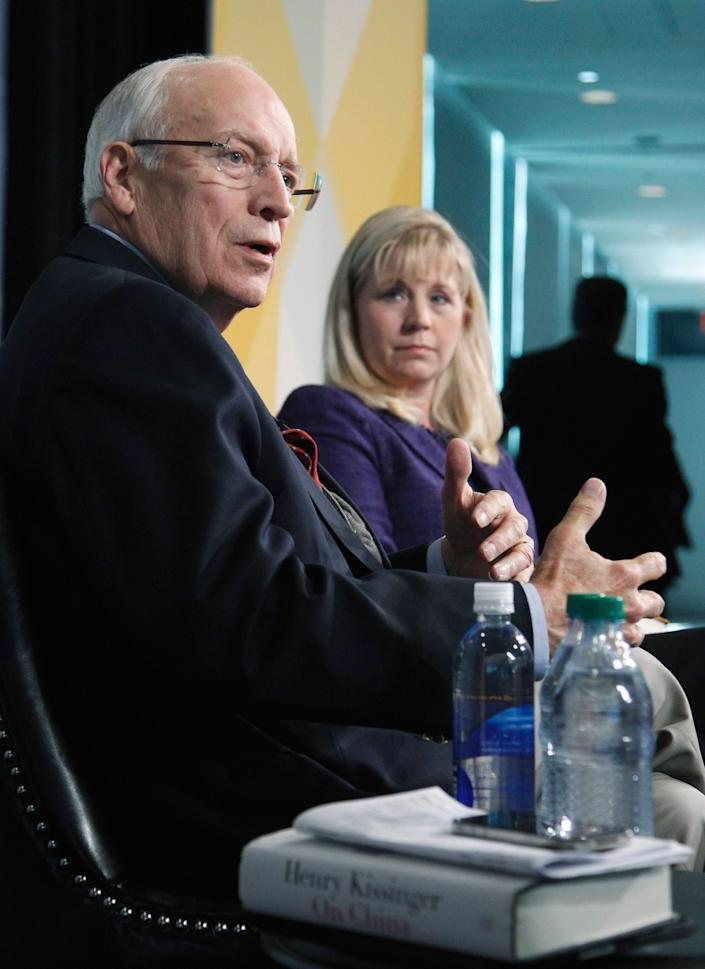 Former Vice President Dick Cheney, accompanied by his daughter Liz Cheney, addresses the third annual Washington Ideas Forum at the Newseum in Washington, Thursday Oct. 6, 2011. (AP Photo/Manuel Balce Ceneta)