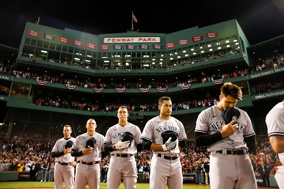 BOSTON, MA - OCTOBER 05: (L-R) Aaron Boone #17  Anthony Rizzo #48  Aaron Judge #99 Giancarlo Stanton #27 of the New York Yankees during the national anthem prior to the game between the New York Yankees and the Boston Red Sox at Fenway Park on Tuesday, October 5, 2021 in Boston, Massachusetts. (Photo by Rob Tringali/MLB Photos via Getty Images)