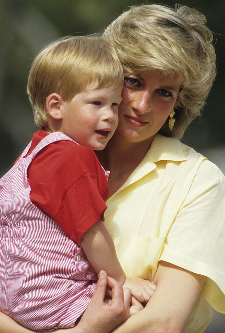 Diana, Princess of Wales holds a young Prince Harry on holiday in Majorca, Spain on August 10, 1987