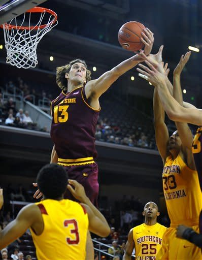 Arizona State center Jordan Bachynski, left, grabs a rebound away from Southern California forward Garrett Jackson (33) during the first half of an NCAA college basketball game, Thursday, Jan. 5, 2012, in Los Angeles. Southern Cal forward Byron Wesley (25) watches the play. (AP Photo/Richard Hartog)