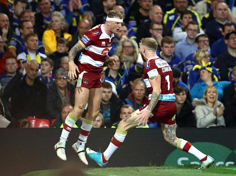 Dom Manfredi celebrates with Sam Tomkins (Getty)
