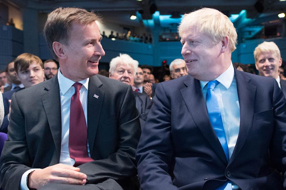Conservative Party leadership contenders Boris Johnson (R) and Jeremy Hunt (L) sit together at an event to announce the winner of the party's leadership contest in central London on July 23, 2019. - Boris Johnson won the race to become Britain's next prime minister on Tuesday, heading straight into a confrontation over Brexit with Brussels and parliament, as well as a tense diplomatic standoff with Iran. (Photo by Stefan Rousseau / POOL / AFP)        (Photo credit should read STEFAN ROUSSEAU/AFP via Getty Images)