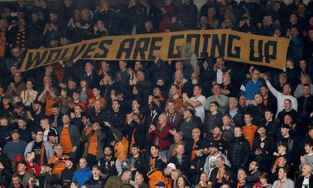 Soccer Football - Championship - Wolverhampton Wanderers vs Birmingham City - Molineux Stadium, Wolverhampton, Britain - April 15, 2018 Wolverhampton Wanderers fans display a banner Action Images via Reuters/Andrew Boyers