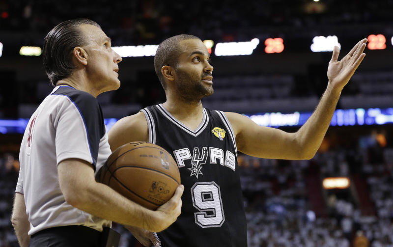 San Antonio Spurs point guard Tony Parker (9) complains to official Ken Mauer (41) during the first half of Game 2 of the NBA Finals basketball game against the Miami Heat, Sunday, June 9, 2013 in Miami. (AP Photo/Lynne Sladky)