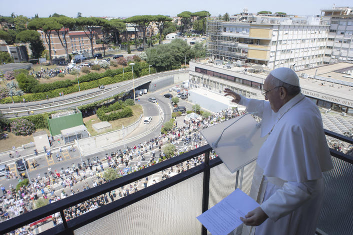 Pope Francis appears at a balcony of the Agostino Gemelli Polyclinic in Rome, Sunday, July 11, 2021, where he was hospitalized for intestine surgery, to deliver his traditional Sunday blessing. (Vatican Media via AP)