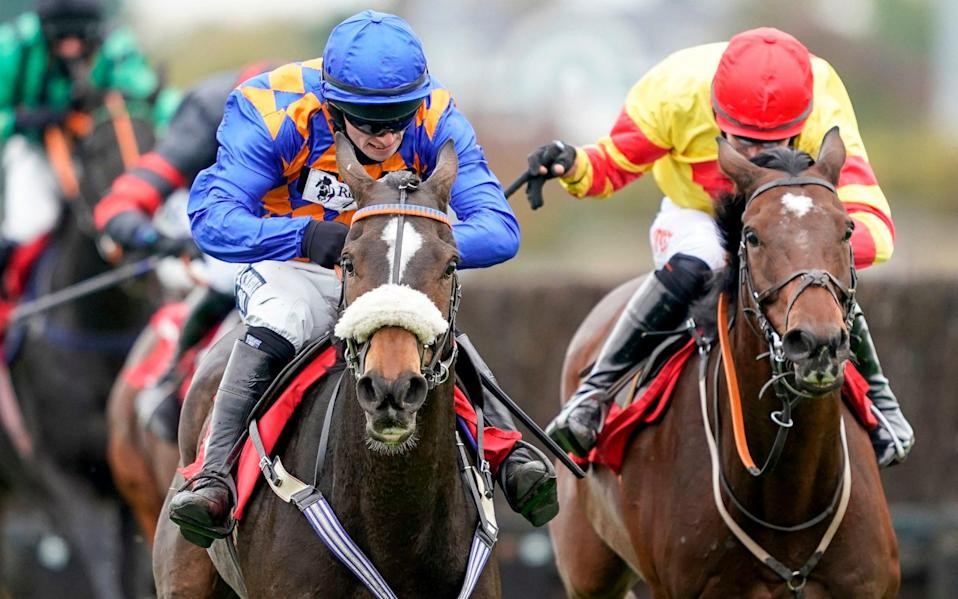 Pontresina ridden by Jonathan Burke (left) clear the last to win The Racing TV Handicap Chaseat Kempton Park - PA