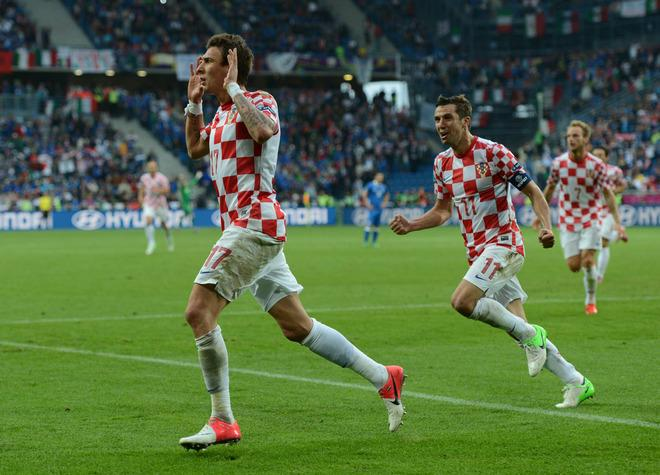Croatian forward Mario Mandzukic (L) celebrates after scoring a goal during the Euro 2012 championships football match Italy vs Croatia on June 14, 2012 at the Municipal Stadium in Poznan. AFP PHOTO / FRANCISCO LEONGFRANCISCO LEONG/AFP/GettyImages