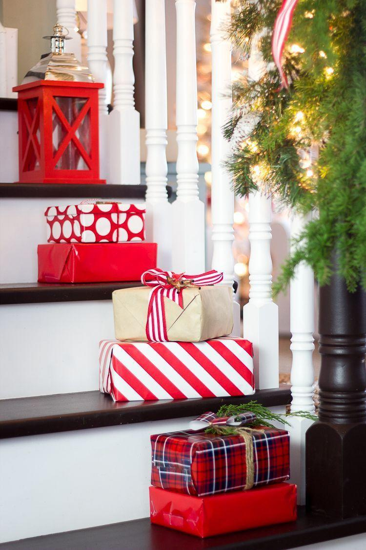 """<p>Place stacks of a few smaller gifts (or empty boxes) on the stairs to give the space an instant upgrade.</p><p><em>See more at <a href=""""https://www.countryliving.com/home-design/decorating-ideas/g23362967/christmas-decorations-for-stairs/?slide=20"""" rel=""""nofollow noopener"""" target=""""_blank"""" data-ylk=""""slk:Craftberry Bush"""" class=""""link rapid-noclick-resp"""">Craftberry Bush</a>.</em></p><p><a class=""""link rapid-noclick-resp"""" href=""""https://www.amazon.com/Hallmark-Reversible-Wrapping-Christmas-Woodland/dp/B07T5WLL6X?tag=syn-yahoo-20&ascsubtag=%5Bartid%7C10072.g.34479907%5Bsrc%7Cyahoo-us"""" rel=""""nofollow noopener"""" target=""""_blank"""" data-ylk=""""slk:SHOP WRAPPING PAPER"""">SHOP WRAPPING PAPER</a></p>"""