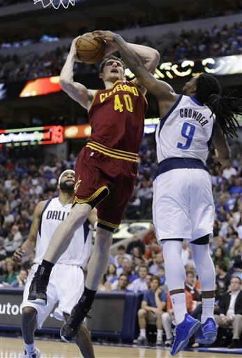 Cleveland Cavaliers center Tyler Zeller (40) is fouled by Dallas Mavericks forward Jae Crowder (9) during the first half of an NBA basketball game Friday, March 15, 2013, in Dallas. (AP Photo/LM Otero)
