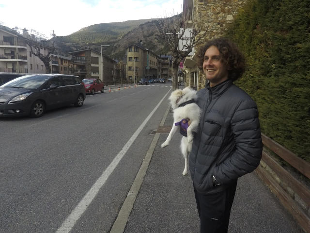 Argentina's Marco Trungelliti holds his dog in the principality of Andorra Monday, April 8, 2019. Blowing the whistle on betting-related corruption that is eating at tennis' credibility has come at a cost for the Argentine whose mad-dash road trip to Roland Garros last year caused a sensation. (AP Photo/John Leicester)