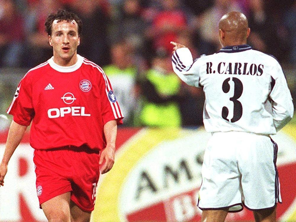 Roberto Carlos shouts at Jens Jeremies during a match in the 2000/01 Champions League: Bongarts/Getty