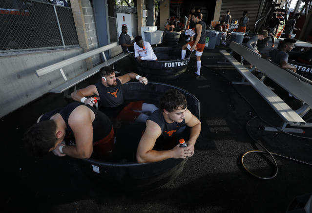Texas Longhorns football players cool down in ice water after practice Wednesday Sept. 4, 2019 in Austin, Tx. ( Photo by Edward A. Ornelas )