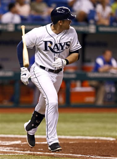 Tampa Bay Rays' Evan Longoria reacts as he watches his grand slam home run during the third inning of a baseball game against the Toronto Blue Jays Monday, May 6, 2013, in St. Petersburg, Fla. (AP Photo/Mike Carlson)