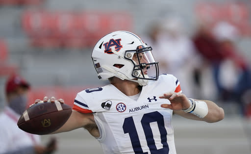 Auburn quarterback Bo Nix warms up for the team's NCAA college football game against Georgia, Saturday, Oct. 3, 2020, in Athens, Ga. (AP Photo/Brynn Anderson)