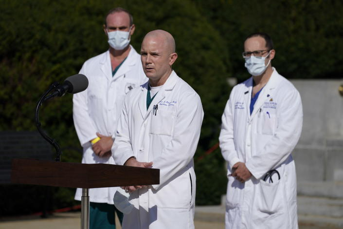 Dr. Jason Blaylock, talks with reporters at Walter Reed National Military Medical Center, Monday, Oct. 5, 2020, in Bethesda, Md. (AP Photo/Evan Vucci)